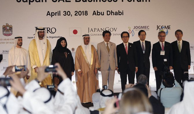 UAE Minister of State and a member of the UAE Federal Cabinet, Dr. Sultan Al-Jaber, 3rd left, UAE minister of Economy, Sultan Al Mansoori, 4th left, and Japanese Prime Minister Shinzo Abe with the others pose for a picture during the Japan-UAE Business Forum in Abu Dhabi, United Arab Emirates.(AP)