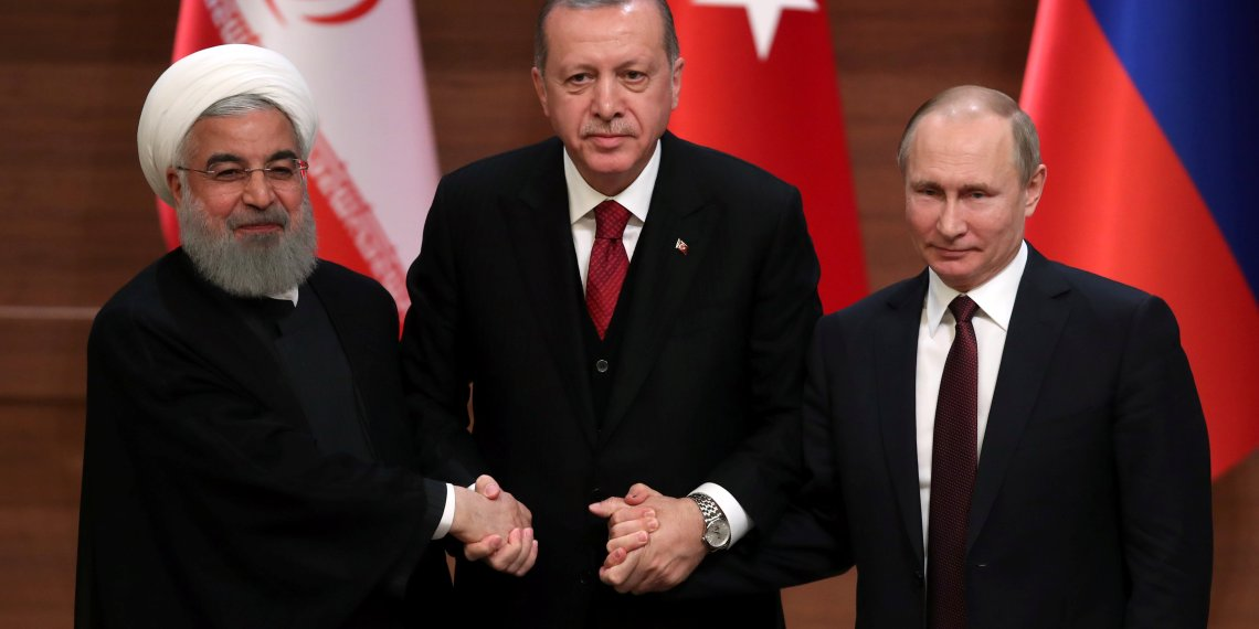 Presidents Hassan Rouhani of Iran, Tayyip Erdogan of Turkey and Vladimir Putin of Russia. REUTERS/Umit Bektas