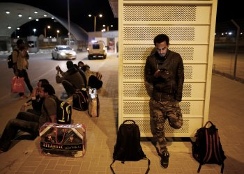 African migrants wait for a bus after being released from Saharonim Prison in the Negev desert, Israel April 4, 2018. REUTERS/Amir Cohen