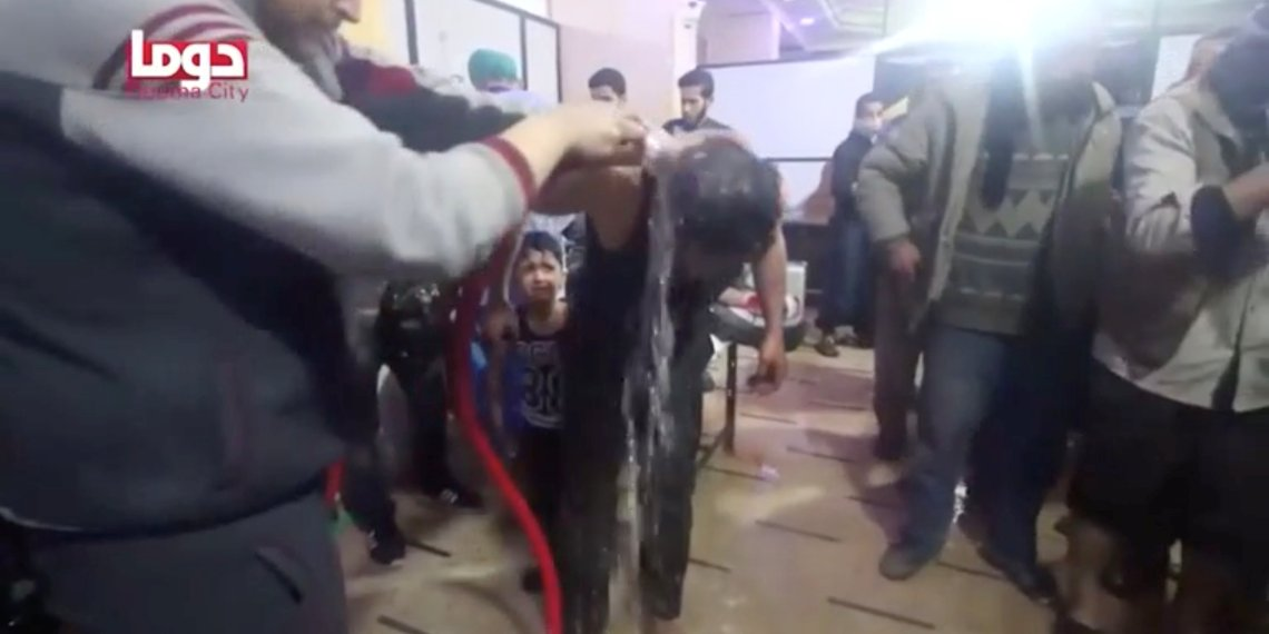 A man is washed following alleged chemical weapons attack, in what is said to be Douma, Syria in this still image from video obtained by Reuters on April 8, 2018. White Helmets/Reuters TV via REUTERS