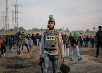 "This photo from April 6 shows journalist Mohammed el Hajjar covering the ""Great March of Return"" protests at the Gaza-Israel border. The following Friday, April 13, he was wounded by Israeli gunfire while continuing his coverage."