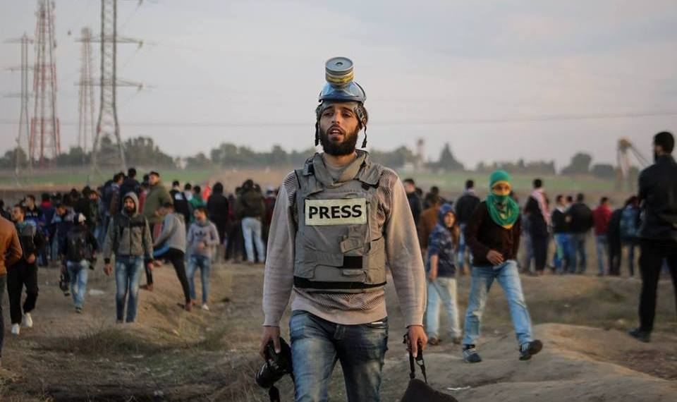 """This photo from April 6 shows journalist Mohammed el Hajjar covering the """"Great March of Return"""" protests at the Gaza-Israel border. The following Friday, April 13, he was wounded by Israeli gunfire while continuing his coverage."""