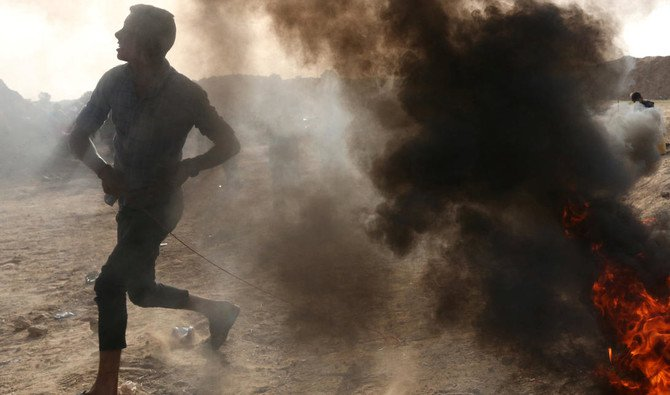 A Palestinian hurts stones at Israeli troops during clashes at Israel-Gaza border in the central Gaza strip early this week /REUTERS