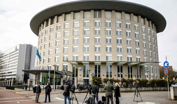 Journalists wait outside the headquarter of Organistaion for the Prohibition of Chemical Weapons OPCW- on April 4,2018 Netherlands / AFP