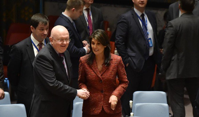 US ambassador to the United Nations, Nikki Haley talks with the Russians ambassador to the United Nations Vassily Nebenzia during a UN Security Council meeting, at United Nations Headquarters in New York discussig chemical attacks in Syria,Apr 10 ,2018 AFP
