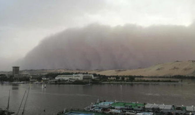 File photo showing a sand storm rolling in over Aswan, Egypt, April 30, 2018 photo shows. (AP)