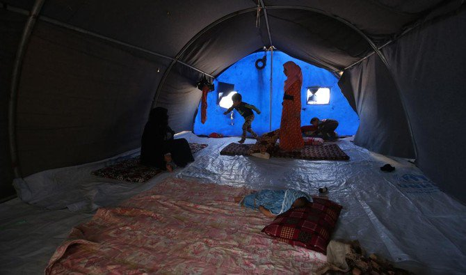 "Displaced Iraqis are seen in a tent where they are taking shelter in ""Camp Seven"" near Al-Khalidiyeh in Iraq's western Anbar province on April 24, 2018. (AFP/ Ahmad Al-Rubaye)"