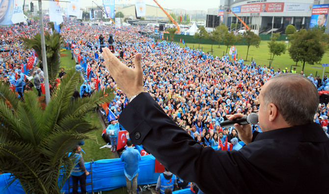 """This handout picture taken and released on May 6, 2018 by the Turkish Presidential Press office shows Turkish President Recep Tayyip Erdogan addressing his supporters during a rally in Istanbul on May 6, 2018. Turkey will hold parliamentary and presidential elections on June 24, 2018, seen as important as it will transform Turkey's governing system to an executive presidency which expands the head of state's powers. Four Turkish opposition parties announced they had formed a coalition to challenge President Recep Tayyip Erdogan in snap elections on June 24. - RESTRICTED TO EDITORIAL USE - MANDATORY CREDIT """"AFP PHOTO / TURKISH PRESIDENTIAL PRESS SERVICE / MURAT CETIN MUHURDAR - NO MARKETING NO ADVERTISING CAMPAIGNS - DISTRIBUTED AS A SERVICE TO CLIENTS / AFP / TURKISH PRESIDENTIAL PRESS SERVICE / Murat CETIN MUHURDAR / RESTRICTED TO EDITORIAL USE - MANDATORY CREDIT """"AFP PHOTO / TURKISH PRESIDENTIAL PRESS SERVICE / MURAT CETIN MUHURDAR - NO MARKETING NO ADVERTISING CAMPAIGNS - DISTRIBUTED AS A SERVICE TO CLIENTS"""