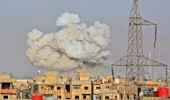 A file photo of smoke rising from buildings during regime strikes on the Palestinian camp of Yarmuk and the neighboring Al-Hajjar Al-Aswad district, in southern Damascus, on May 1, 2018. (Rami Al-Sayed/AFP)