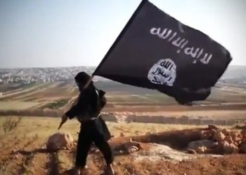 "An image grab taken from a video uploaded on YouTube on August 23, 2013 allegedly shows a member of Ussud Al-Anbar (Anbar Lions), a Jihadist group affiliated to the Islamic State of Iraq and the Levant (ISIL), Al-Qaeda's front group in Iraq, holding up the trademark black and white Islamist flag at an undisclosed location in Iraq's Anbar province. Attacks in Iraq killed 14 people including six soldiers on August 25, Iraqi officials said, amid a surge in violence authorities have so far failed to stem despite wide-ranging operations targeting militants. Arabic writing on the flag reads: ""There is not God but God and Mohammed is the prophet of God."" AFP PHOTO / YOUTUBE == RESTRICTED TO EDITORIAL USE - MANDATORY CREDIT ""AFP PHOTO / YOUTUBE "" - NO MARKETING NO ADVERTISING CAMPAIGNS - DISTRIBUTED AS A SERVICE TO CLIENTS FROM FROM ALTERNATIVE SOURCES, THEREFORE AFP IS NOT RESPONSIBLE FOR ANY DIGITAL ALTERATIONS TO THE PICTURE'S EDITORIAL CONTENT, DATE AND LOCATION WHICH CANNOT BE INDEPENDENTLY VERIFIED ==== / AFP PHOTO / YouTube / -"