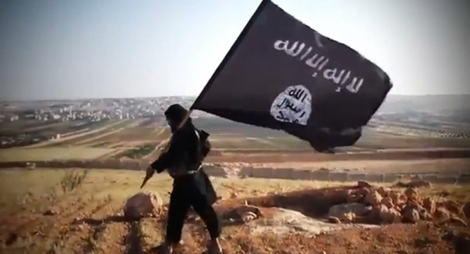 """An image grab taken from a video uploaded on YouTube on August 23, 2013 allegedly shows a member of Ussud Al-Anbar (Anbar Lions), a Jihadist group affiliated to the Islamic State of Iraq and the Levant (ISIL), Al-Qaeda's front group in Iraq, holding up the trademark black and white Islamist flag at an undisclosed location in Iraq's Anbar province. Attacks in Iraq killed 14 people including six soldiers on August 25, Iraqi officials said, amid a surge in violence authorities have so far failed to stem despite wide-ranging operations targeting militants. Arabic writing on the flag reads: """"There is not God but God and Mohammed is the prophet of God."""" AFP PHOTO / YOUTUBE == RESTRICTED TO EDITORIAL USE - MANDATORY CREDIT """"AFP PHOTO / YOUTUBE """" - NO MARKETING NO ADVERTISING CAMPAIGNS - DISTRIBUTED AS A SERVICE TO CLIENTS FROM FROM ALTERNATIVE SOURCES, THEREFORE AFP IS NOT RESPONSIBLE FOR ANY DIGITAL ALTERATIONS TO THE PICTURE'S EDITORIAL CONTENT, DATE AND LOCATION WHICH CANNOT BE INDEPENDENTLY VERIFIED ==== / AFP PHOTO / YouTube / -"""