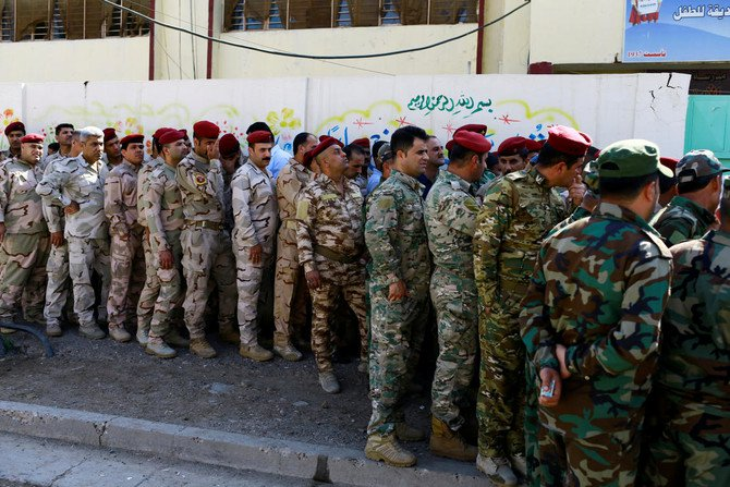 Iraqi security members arrive to cast their vote at a polling station, two days before polls open to the public in a parliamentary election in Baghdad, Iraq May 10, 2018. (Reuters)
