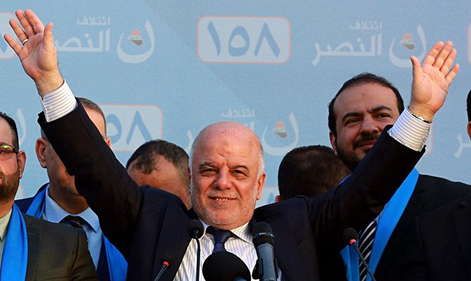 In this May 1, 2018 file photo, Iraq Prime Minister Haider al-Abadi, speaks during a campaign rally in Baghdad, Iraq. (AP Photo/Hadi Mizban, File)