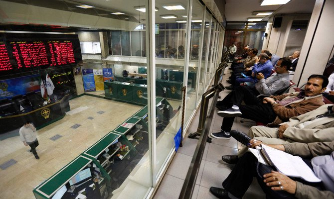 Iranians monitor the stock market at the stock exchange in Tehran on May 8, 2018. Renewed nuclear sanctions would certainly cause severe problems for Iran's economy, but much of the damage has already been done by the uncertainty created by the US and myriad home-grown problems. (AFP / ATTA KENARE)