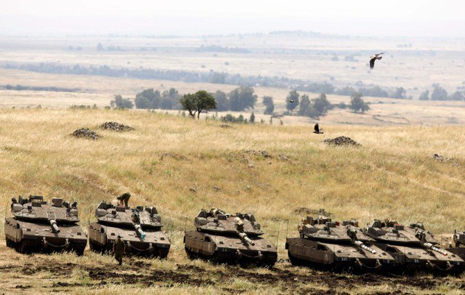 Israeli Merkava tanks are seen in a deployment area near the Syrian border in the Israel-annexed Golan Heights on May 10, 2018. (AFP)
