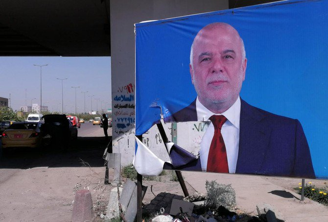 In this Monday, April 23, 2018 photo, campaign poster of Iraqi Prime Minister Haider Al-Abadi is displayed in Baghdad, Iraq. (AP)