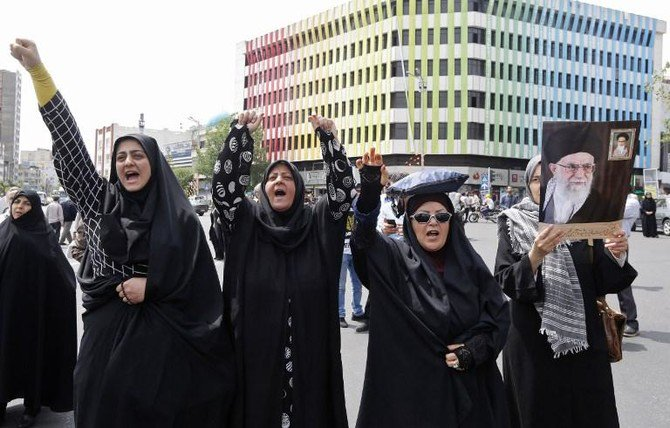 Iranians chant anti-US slogans during a demonstration after Friday prayer in Tehran on May 11. Donald Trump's move to ditch the nuclear deal has infuriated Washington's allies in Europe as well as China and Russia. (AFP)