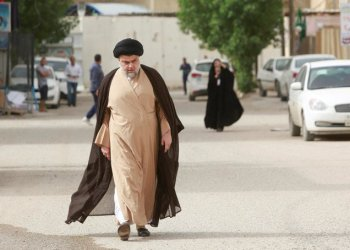 File photo showing Iraqi Shiite cleric Moqtada Al-Sadr on his way to cast his vote at a polling station during the parliamentary election in Najaf, Iraq, May 12, 2018. (Reuters)