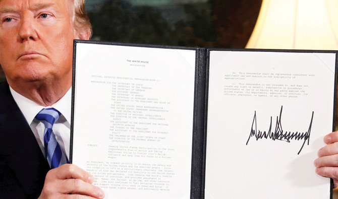 US President Donald Trump holds up a proclamation declaring his intention to withdraw from the Iran nuclear agreement. (REUTERS/File)