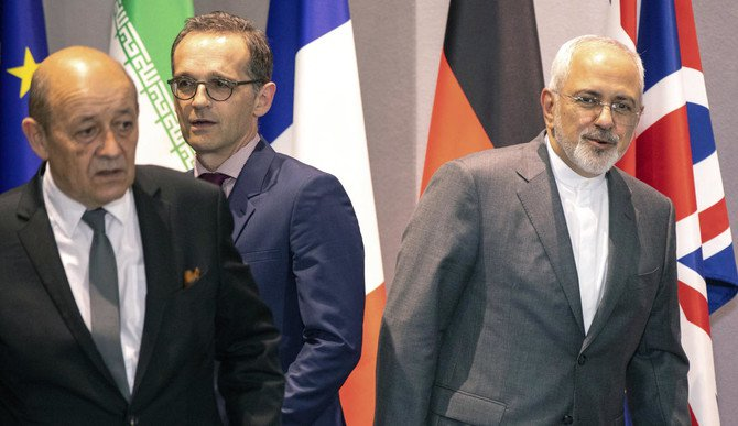From left, French Foreign Minister Jean-Yves Le Drian, German Foreign Minister Heiko Maas and Iranian Foreign Minister Javad Zarif walk, during a meeting of the foreign ministers from Britain, France and Germany with the Iran Foreign Minister and EU foreign policy chief Federica Mogherini, at the Europa building in Brussels, Tuesday, May 15, 2018. (AP/Olivier Matthys, Pool)