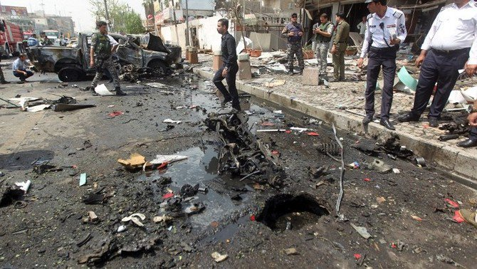 In this file photo, Iraqi security forces inspect the scene of a car-bomb blast targeting Shiite pilgrims on an annual march to Baghdad. (AFP)