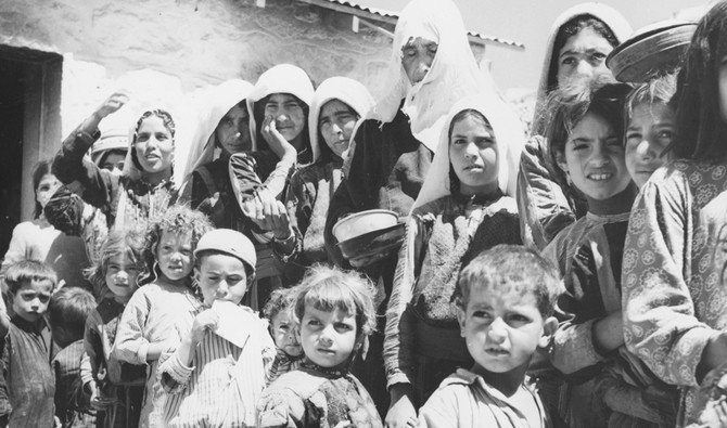 Palestinian refugees from Israel form a queue by the food tent in their camp in Amman. (Getty Images/file)