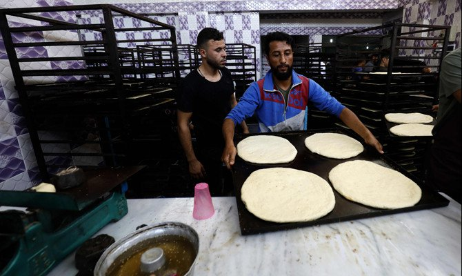 Artisans prepare sweet bread at a bakery in the Syrian city of Raqqa on Thursday, during the holy month of Ramadan. (AFP)