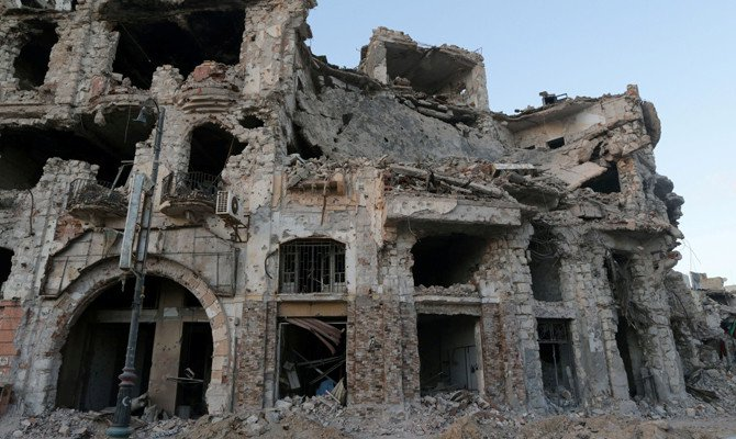 A historic building that was destroyed during a three-year conflict is seen in Benghazi, Libya, on February 28, 2018. A car bomb explodsion on a busy street in the center of Benghazi on Thursday night killed at least seven people. (REUTERS/Esam Omran Al-Fetori/File Photo)