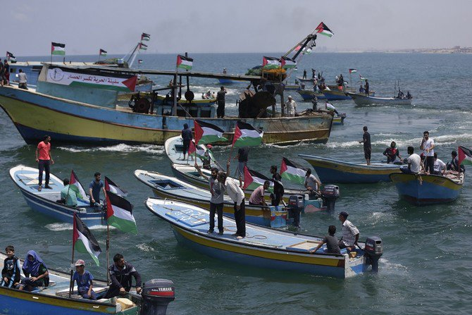 Fishing boats carrying a group of Palestinian activists who are protesting and perhaps trying to breach Israel's naval blockade on Gaza, setting to sail from Gaza City harbor. (AFP)