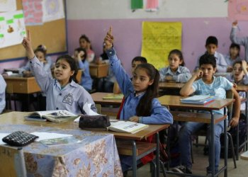 May 22, 2018 photo, Sarah, center, a Palestinian refugee from Syria participates in an English lesson at the Jafna Elementary school, run by the UN Agency for Palestinian Refugees, UNRWA, in the eastern Bekaa Valley town of Taalabaya, Lebanon. (AP/Hassan Ammar)