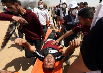 A wounded Palestinian is evacuated during a protest where Palestinians demand the right to return to their homeland, at the Israel-Gaza border in the southern Gaza Strip, May 11, 2018. REUTERS/Ibraheem Abu Mustafa