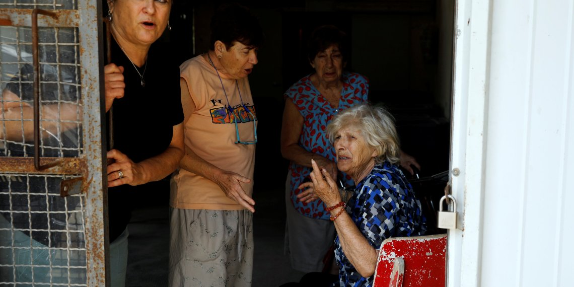 Women react after a siren is sounded, in a Kibbutz on the Israeli side of the Israeli-Gaza border, May 29, 2018. REUTERS/Amir Cohen