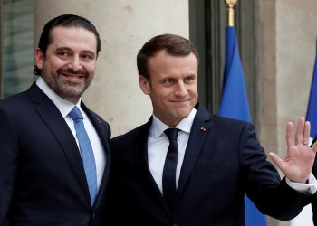 FILE PHOTO: French President Emmanuel Macron and Saad al-Hariri react on the steps of the Elysee Palace in Paris, France, November 18, 2017. REUTERS/Benoit Tessier -/File Photo
