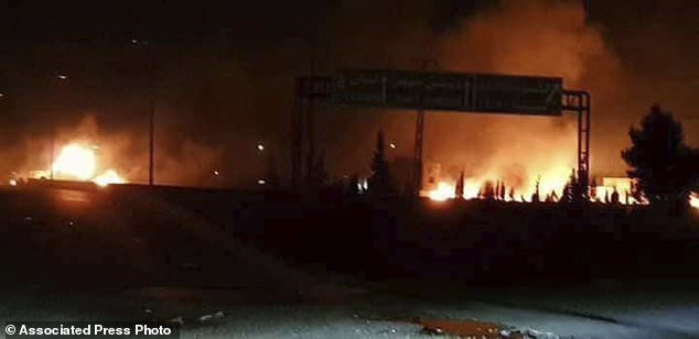 This photo released on Wednesday, May 9, 2018, by the Syrian official news agency SANA, shows flames rising after an attack in an area known to have numerous Syrian army military bases, in Kisweh, south of Damascus, Syria. Syrian state-run media said Israel struck a military outpost near the capital Damascus on Tuesday, saying its air defenses intercepted and destroyed two of the incoming missiles. The reported attack came shortly after U.S. President Donald Trump announced he was withdrawing from the Iran nuclear deal, calling Tehran a main exporter of terrorism in the region. (SANA via AP)
