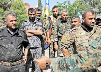 Members of the Manbij military council wait prior to a press conference in Manbij on Wednesday. (AFP)