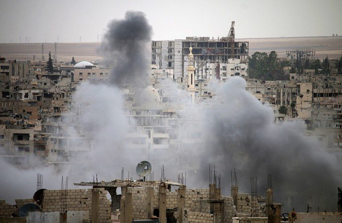 Smoke rises from buildings in a rebel-held neighbourhood of Daraa in southern Syria following reported shelling by the regime on May 22, 2018. (AFP)