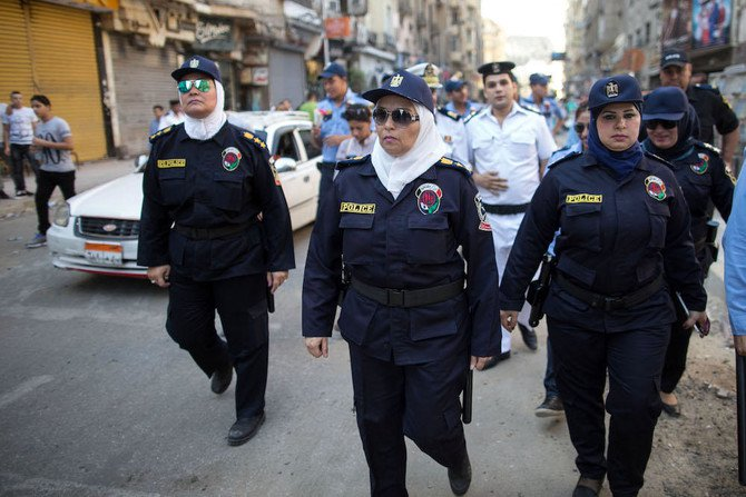 Egyptian policewomen who are part of a new anti-harassment force patrol in Cairo on the first day of Eid Al-Fitr. The force is a new initiative by the Ministry of Interior to combat sexual harassment in the streets, which in past years has spiked in Cairo during the holiday celebrations with the crowds of rowdy men in the streets (File photo: AP)