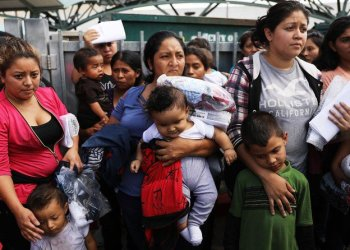 Dozens of women and their children, many fleeing poverty and violence in Honduras, Guatamala and El Salvador, arrive at a bus station following release from Customs and Border Protection on June 22, 2018 in McAllen, Texas. (Spencer Platt/Getty Images/AFP)