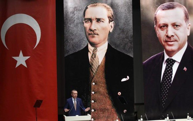 Prime Minister Recep Tayyip Erdogan makes a speech in front of portraits of himself, right, and Mustafa Kemal Ataturk. Erdogan is poised to take on extensive new executive powers following his outright election victory in Sunday's poll. (Getty Images)