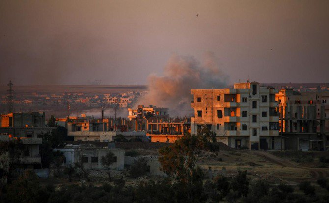 Smoke rises above opposition held areas of Daraa during airstrikes by Syrian regime forces on June 26, 2018. Russian-backed regime forces have for weeks been preparing an offensive to retake Syria's south, a strategic zone that borders both Jordan and the Israeli-occupied Golan Heights. /(AFP)