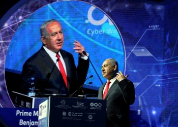 Israeli Prime Minister Benjamin Netanyahu gestures as he speaks during the Cyber Week conference at Tel Aviv University, Israel June 20, 2018. REUTERS/Ammar Awad