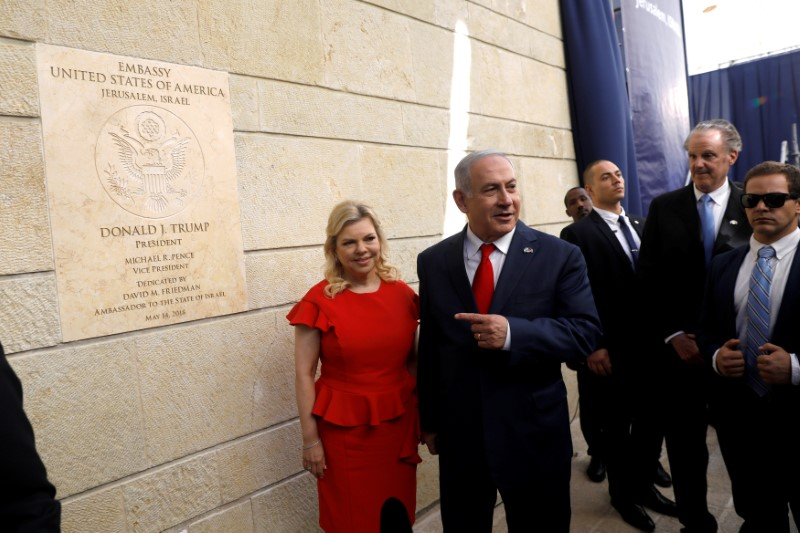 FILE PHOTO: Israeli Prime Minister Benjamin Netanyahu and his wife Sara Netanyahu stand next to the dedication plaque of the U.S. embassy in Jerusalem, after the dedication ceremony of the new U.S. embassy in Jerusalem, May 14, 2018. REUTERS/Ronen Zvulun/File Photo