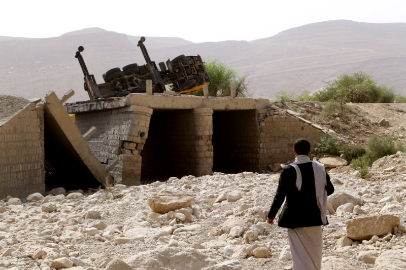 A man inspects damage of an airstrike on a truck in the northwestern city of Saada, Yemen June 21, 2018. REUTERS/Naif Rahma