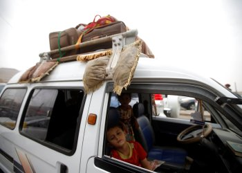 A displaced boy from Hodeidah city sleeps inside a van as they reach Sanaa, Yemen June 21, 2018. REUTERS/Mohamed al-Sayaghi?