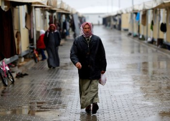 FILE PHOTO: A Syrian refugee man walks in Elbeyli refugee camp near the Turkish-Syrian border in Kilis province, Turkey, December 1, 2016. REUTERS/Umit Bektas/File Photo