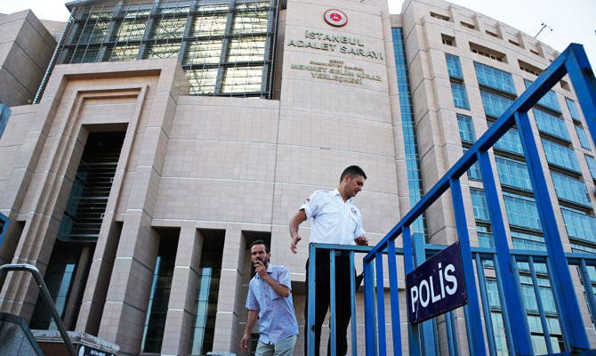 A security guard adjusts barriers outside a court where the trial of journalists of the now-defunct Zaman newspaper on charges of aiding terror groups was held, in Istanbul, Friday, July 6, 2018. (AP)