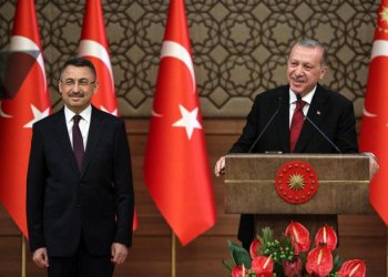 Turkey's President Recep Tayyip Erdogan (R) presents Turkey's new Vice President Fuat Oktay (L) during a news conference at the Presidential Palace in Ankara, on July 9, 2018. (AFP/ADEM ALTAN)