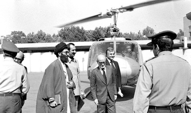 In this Feb. 5, 1979 file photo, Abbas Amir-Entezam is seen with newly appointed Iran Prime Minister Mehdi Bazargan, Dariush Forouha and Ayatollah Khamenei arriving at an airport in Iran after the fall of the Pahlavi regime. (Wikimedia Commons)