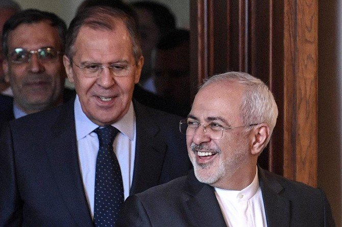 Russian Foreign Minister Sergei Lavrov (L) and his Iranian counterpart Mohammad Javad Zarif enter a hall during a meeting in Moscow on April 28, 2018. (AFP)