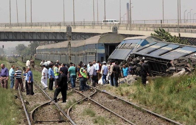 In this file photo, Egyptians check the wreckage of a train after it derailed near the village of Al-Ayyat in Giza on the southern outskirts of the capital Cairo. Egypt's railway authority said a passenger train derailed on a railway track in Cairo's twin city, Giza, on Friday. (AFP)
